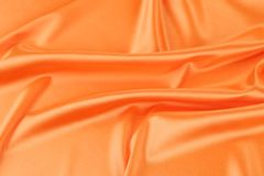 Orange silk background. Stock Images
