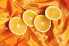 Orange on a silk background. Stock Photo