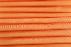 Orange silk. Background with some soft folds and highlights stock photo