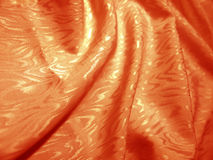 Orange silk with texture of moire Royalty Free Stock Photo
