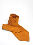 An orange silk tie. An orange patterned silk tie Royalty Free Stock Image