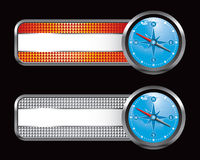 Orange and silver checkered tabs with blue compass Royalty Free Stock Photos