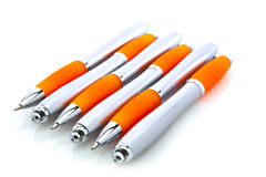 Orange and silver pens royalty free stock photo