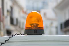 Orange siren. In a street Stock Images