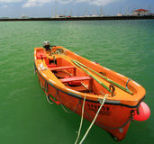 Orange Skiff, St. Martin. A brilliant orange skiff floats under the tropical sun in Marigot, St. Martin Stock Photography