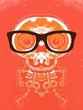 Orange skull and bone with brown glasses. And orange background Royalty Free Stock Images