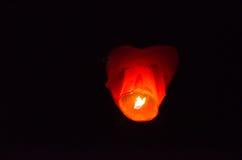 Orange sky lantern Stock Images