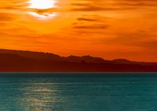 Surreal scene of a sunrise over the sea royalty free stock images