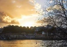 Orange sky from Porto in front of the river. Sundown urban landscape in a melancholic orange autumn. Seaport contrasty scene Stock Photography
