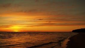 Sunset sea coast orange sky and clouds Stock Photo