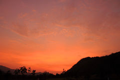 Orange sky after sunset with mountain Stock Image