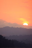 Orange sky sunset over a mountain Royalty Free Stock Photography