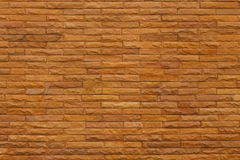 Orange slate stone wall for pattern and background Royalty Free Stock Image