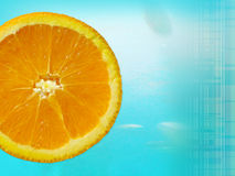 Orange slice. Fresh orange slice on a blue water background with room for text Stock Images