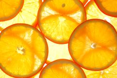 Orange slice. Fresh orange slice on a bright backround Stock Photos
