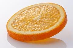 Orange slice. Close-up of orange slice on white background Stock Image