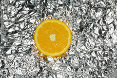 Orange slice. Close up Orange slice on the foil stock photo