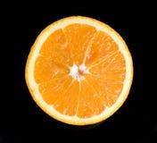 Orange slice. Juice orange slice on black background Royalty Free Stock Image