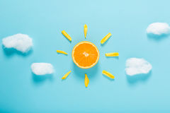 Orange slice as the sun concept Royalty Free Stock Images