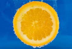 Orange Slice With Bubbles Royalty Free Stock Photography