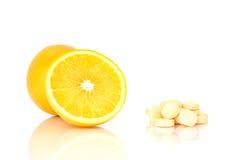 Orange slice and c vitamin pills Stock Photos