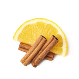 Orange slice and cinnamon isolated Royalty Free Stock Image