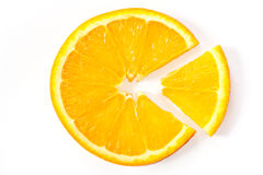 The orange slice with the cut-out piece Stock Image