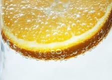 Orange slice dipped stock images