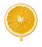 Orange slice with drop of juice Stock Photo