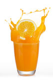 Orange slice drop in orange juice Royalty Free Stock Photography