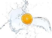 Orange slice falling and splashing into water. Royalty Free Stock Photo