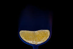 Orange slice on fire Royalty Free Stock Photos