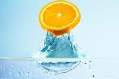 Orange slice 2. Fresh orange slice splashing in water Stock Photos