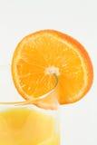 Orange slice on glass. Stock Photos