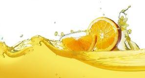 Orange slice in juice stream.  royalty free stock image