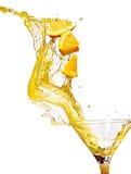 Orange slice in juice stream Stock Images