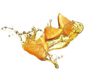 Orange slice in juice stream Stock Photography
