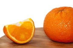 Orange and slice of orange Stock Images
