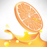 Orange slice plash juice Stock Photos