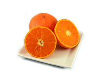 Orange slice  on plate Stock Image