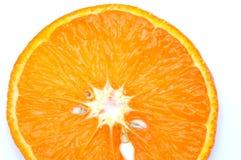 Orange slice with seeds Stock Photography