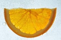 Orange slice in soda water stock images