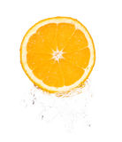 Orange slice in splash Royalty Free Stock Images