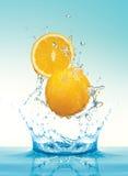 Orange slice with splashing water stock images
