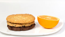 Orange slice and three cookies Stock Image