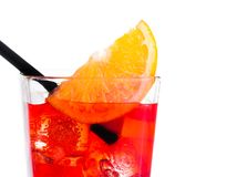 Orange slice on top of the red cocktail with ice cubes and straw on white background Royalty Free Stock Photos