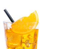 Orange slice on top of the yellow cocktail with ice cubes and straw on white background Royalty Free Stock Photography