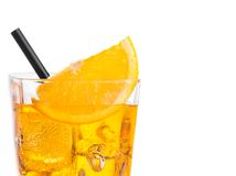 Orange slice on top of the yellow cocktail with ice cubes and straw on white background Royalty Free Stock Photos