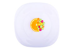 Orange slice with vitamins Stock Images