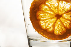 Orange slice in water with bubbles. Orange slice in glass of water with bubbles Stock Photos